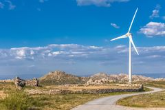 View of a wind turbine on top of mountains. In Portugal environment electricity mill technology environmental nature windmill industry sky energy power royalty free stock photography
