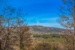 View of a wind turbines on top of mountains. In Portugal environment electricity mill technology environmental nature windmill industry sky energy power stock images