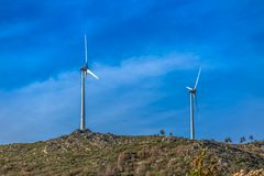 View of a wind turbines on top of mountains. In Portugal environment electricity mill technology environmental nature windmill industry sky energy power stock image