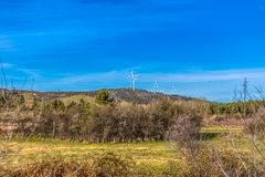 View of a wind turbines on top of mountains. In Portugal environment electricity mill technology environmental nature windmill industry sky energy power stock photography