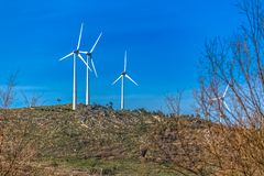 View of a wind turbines on top of mountains. In Portugal environment electricity mill technology environmental nature windmill industry sky energy power stock photo