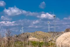 View of a wind turbines on top of mountains. In Portugal environment electricity mill technology environmental nature windmill industry sky energy power royalty free stock photos