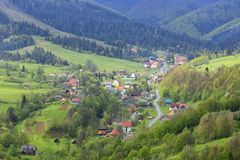 View of the winding road passing through the Carpathian village royalty free stock photo