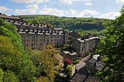 A view of the winding streets and tall stone houses in hebden bridge se in the surrounding west yorkshire countryside. With pennine hills and bright summer royalty free stock image
