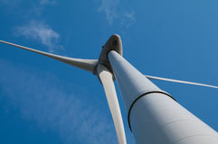 View on a windmill. Down to up view on a windmill and blue sky Royalty Free Stock Photos