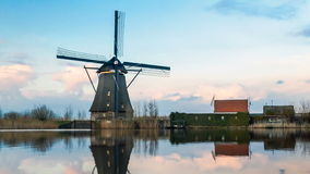 View of Windmill and reflection in Kinderdijk Village stock video footage
