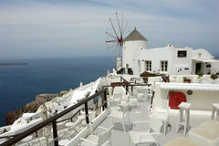 View with windmill and restaurant on Santorini Island. Royalty Free Stock Photography