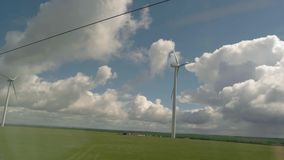 View of windmills from train. stock video footage