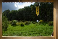View from window. With wind chime at sunny day at nature Royalty Free Stock Images