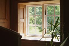 View through a window. On the second floor of an old wooden house Royalty Free Stock Images