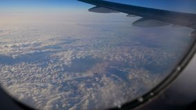 View from the window of aircraft on the wing and plane flying under them stock video footage