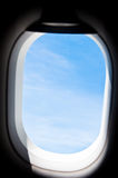 View from the window of an airplane flying in the clouds Stock Photos