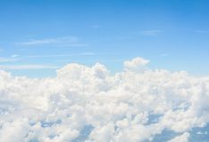 View from the window of an airplane flying in the clouds Stock Image