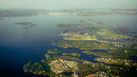 View from window of airplane flying over Norway Scandinavia. Royalty Free Stock Images