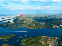 View from window of airplane flying over Norway Scandinavia. Birds eye. View from window of plane airplane flying over fjords Norway Scandinavia Stock Photos