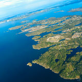 View from window of airplane flying over Norway Scandinavia. Royalty Free Stock Image