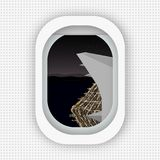 A view from a window of an airplane flying over the shore of the night city. Flat style. stock illustration