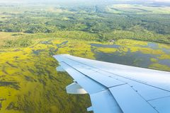 View from window of airplane to forests, fields, lakes, swamps. View from window airplane to forests, fields, lakes, swamps royalty free stock photography