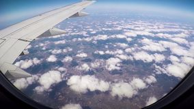 View From Window Of Airplane On Wing Of Aircraft Flight, Sun`s Rays And Clouds. View from window of wing aircraft in flight. Bit of turbulence. Sun`s rays and stock video footage