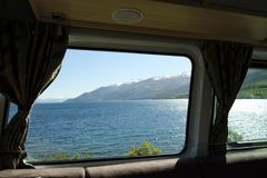 The view through the window of a campervan. Of Lake Wakatipu New Zealand stock image