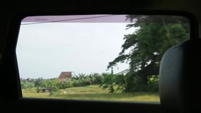 View from window of car in Bali stock footage
