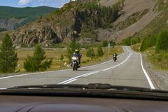 View from the window of the car to two sports motorcycles travel royalty free stock images