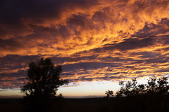 View from the window. Dramatic sunset like fire in the sky with Stock Photos