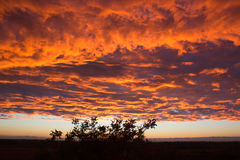 View from the window. Dramatic sunset like fire in the sky with Stock Image