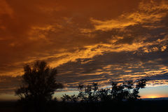 View from the window. Dramatic sunset like fire in the sky with Royalty Free Stock Images