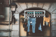 View of window with drying clothes. Close up view of facade of historical residential building in Barcelona district El Born with lantern, plants and a lot of Stock Image