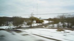 View from the window of a fast-moving train. View from the window of a fast moving train recorded on camera stock video
