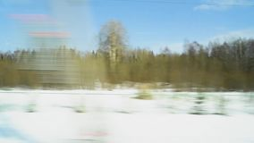 View from the window of a fast-moving train. View from the window of a fast moving train recorded on camera stock video footage