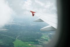 View from window flight on air with flight wing with beautiful blue sky and cloud royalty free stock photo