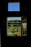 A view from a Window of a French Formal Garden. Stock Photo