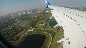 View from the window of an Jet Airplane flying low over the city. stock footage