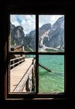 View from the window of Lake Braies with vivid colors in spring with mountains in the background