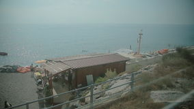 View from the window of a moving train. View on the beach from the window of a moving train stock footage