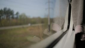 View from the window of moving train. Green nature, sunny day in the view. Outdoor, suburb stock video