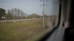 View from the window of moving train. Green nature, sunny day in the view. Outdoor, suburb stock footage