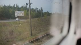 View from the window of moving train. Green nature, sunny day in the view. Outdoor, suburb stock video footage