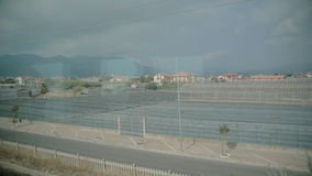 View from the window of a moving train stock video