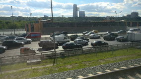 The view from the window of a moving train on the traffic on the highway
