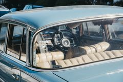 View through the window of old blue Mercedes-Benz 600 parked in London, UK, on a sunny day. London, UK - February 23, 2019: View through the window of old blue stock images