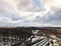 The view from the window of the old city cemetery in the park from a height with trees and houses in the winter. royalty free stock image