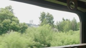 View of green trees and grass from window of old moving train. View from window of old moving train.HD stock video