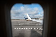 View through the window of a passenger aircraft at the airport. Royalty Free Stock Photography