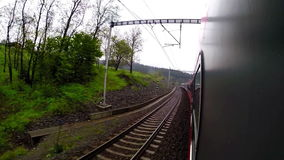 View from the window: passenger train is en route to its next station. 
