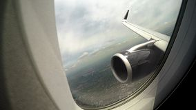 View through window at plane wing and engine, risk of accident during flight. Stock photo stock photo