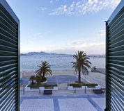 View from a window at the Port de Pollenca in northern Majorca - Stock Image