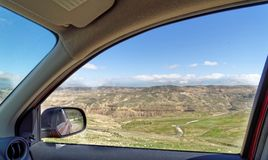 View through the window of a rental car to the edge of Dana Biosphere Reserve, Jordan. Middle east royalty free stock photo